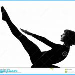 Woman paripurna navasana boat pose yoga posture position in silouhette ...