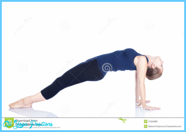 Yoga purvottanasana pose by beautiful Caucasian woman in blue Capri ...