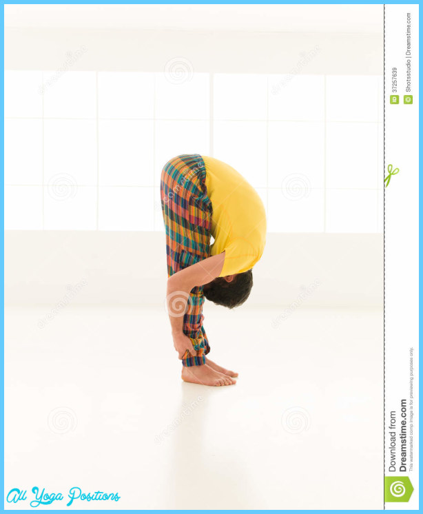 Colorful dressed male repeating Uttanasana yoga exercises in a white ...