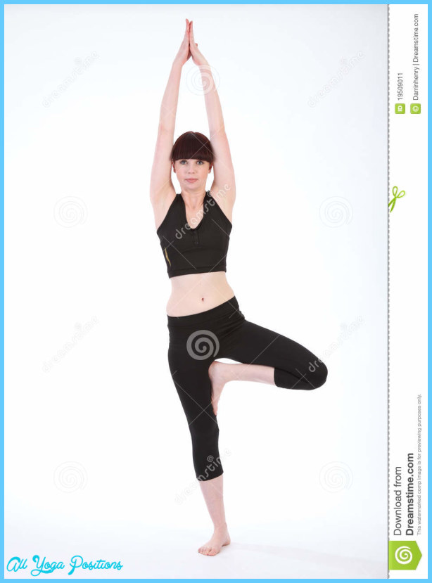Yoga fitness demonstration of Tree Pose Vrksasana, by beautiful young ...