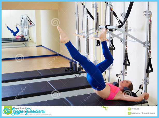 pilates-reformer-woman-tower-exercise-workout-gym-indoor-58759790.jpg