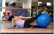 stock-photo-a-young-woman-exercising-at-the-gym-with-a-blue-pilates-exercise-ball-between-her-legs-the-photo-39574360.jpg