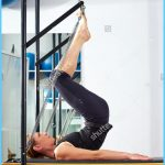 stock-photo-pilates-woman-in-reformer-tower-exercise-at-gym-indoor-309147539.jpg
