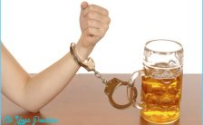 women_handcuffed_to_alcohol_drink.jpg