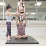 acro yoga sitting on the lotus blossom 10