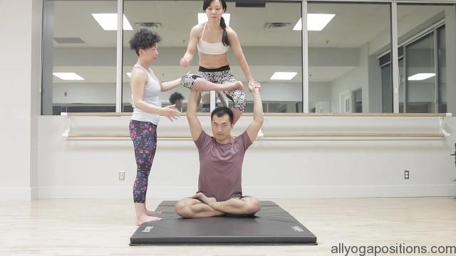 acro yoga sitting on the lotus blossom 8
