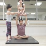 acro yoga sitting on the lotus blossom 9