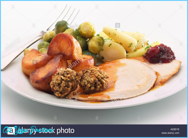 Plate of Christmas dinner with turkey, stuffing, roast potatoes