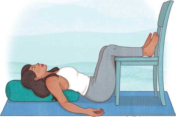 restorative yoga poses heart pose with a chair